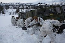 U.S. Marines with Company G, 2nd Battalion, 2nd Marine Regiment, 2nd Marine Division dig a path for a Bandvagn 206 to move through the snow. Marines and Norwegian soldiers spent three days learning to work together and how to operate in the Norwegian winter environment to prepare the Marines and soldiers for Exercise Cold Response, which is a multinational and multilateral training exercise. The exercise will feature various types of military training including maritime, land and air operations. The location, above the Arctic Circle in northern Norway, provides a unique cold-weather environment for all forces involved to learn and develop procedures from one another.