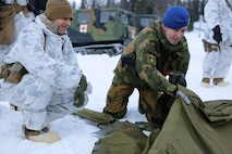 U.S. Marines with Company G, 2nd Battalion, 2nd Marine Regiment, 2nd Marine Division learn how to set up ten-man tents from the Norwegian Army Host Nation Support Battalion during a short field exercise, March 3, 2014. The Marines and Norwegian soldiers spent three days learning to work together and how to operate in the Norwegian winter environment to prepare the Marines and soldiers for Exercise Cold Response, which is a multinational and multilateral training exercise. The exercise will feature various types of military training including maritime, land and air operations. The location, above the Arctic Circle in northern Norway, provides a unique cold-weather environment for all forces involved to learn and develop procedures from one another.