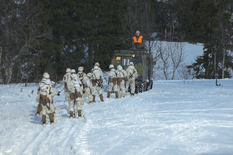Giskaas, Norway – Marines with Golf Company, 2nd Battalion, 2nd Marine Regiment, 2nd Marine Division are pulled on skis by a Bandvagn 206 during a pre-environmental training field exercise to prepare them for exercise Cold Response 2014. Marines and Norwegian soldiers spent three days learning to work together and how to operate in the Norwegian winter environment to prepare the Marines and soldiers for Exercise Cold Response, which is a multinational and multilateral training exercise. The exercise will feature various types of military training including maritime, land and air operations. The location, above the Arctic Circle in northern Norway, provides a unique cold-weather environment for all forces involved to learn and develop procedures from one another.