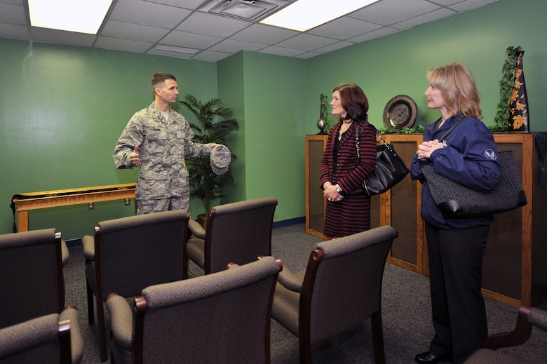 Maj. Trent Davis talks to Betty Welsh, wife of Air Force Chief of Staff Gen. Mark A. Welsh III, and Athena Cody, wife of Chief Master Sgt. of the Air Force James A. Cody, March 6, 2014, inside the Airman Resilience Center at Altus Air Force Base. The Base Chapel created the ARC to help cater to base members of all religions and create a social gathering location that can be used by all members. Davis is the 97th Air Mobility Wing head chaplain. (U.S. Air Force photo/Senior Airman Dillon Davis)