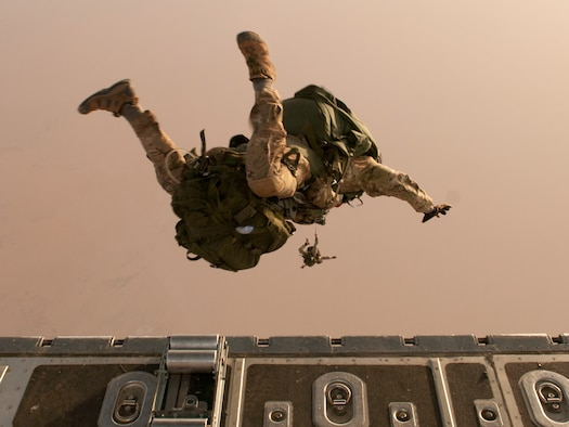 A combat controller team from the 720th Special Tactics Group exits a C-130 Hercules during a high-altitude, high-opening jump during Joint Exercise Flintlock Feb. 28, 2014, over northeastern Niger. Flintlock is an annual, African-led, military exercise focused on security, counter-terrorism and military humanitarian support to outlying areas hosted each year by a different government in western Africa. (U.S. Air National Guard photo/Tech. Sgt. Eugene Crist)