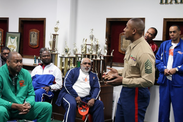 Master Sgt. Mark McArthur, the Marine Corps Recruiting Command Diversity Chief and a Jackson, Miss. native, speaks to the coaches of the men's and women's basketball teams from the 13 colleges and universities of the Mid Eastern Athletic Conference basketball tournament, March 8. McArthur spoke of the importance of Historically Black Colleges and Universities, and how the Marine Corps can work with the coaches and teams to motivate the players, such as the Marine Corps' Combat Fitness Test. The coaches and Marines met before the MEAC Youth Clinic, in which the coaches and Marines worked with nearly 100 young people from the Norfolk area Boys and Girls Clubs, teaching some basic warmup and exercise routines, as well as, basketball fundamentals. The event gave the coaches and Marines an opportunity to make a positive impact on the Norfolk community.