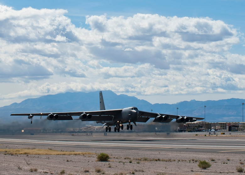 A B-52 Stratofortress assigned to the 96th Bomb Squadron takes off during Red Flag 14-2 March 4, 2014, at Nellis AFB, Nev. Red Flag provides Airmen realistic combat scenarios to improve their improve operational readiness. (U.S. Air Force photo/Airman 1st Class Thomas Spangler)