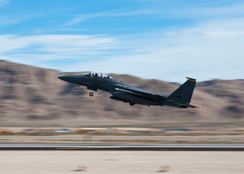 An F-15E Strike Eagle assigned to the 336th Fighter Squadron takes off during Red Flag 14-2 March 4, 2014, at Nellis AFB, Nev. Red Flag gives Airmen an opportunity to experience realistic combat scenarios, and prepares them for future real-world operations. (U.S. Air Force photo/Airman 1st Class Thomas Spangler)