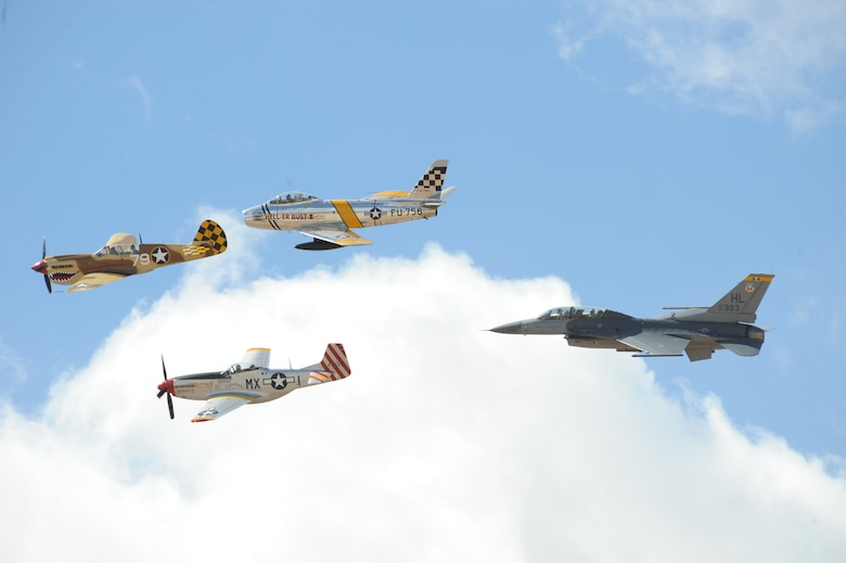 An F-16 Fighting Falcon joins in formation with a P-40 Warhawk (front), P-51 Mustang (bottom), and an F-86 Sabre (top) during the Heritage Flight Training Course March 2, 2014, over Davis-Monthan Air Force Base, Ariz. During the course, aircrews practiced ground and flight training to allow civilian pilots of historic military aircraft and current Air Force fighter pilots to safely fly in formations together. (U.S Air Force photo/ Airman 1st Class Cheyenne Morigeau)