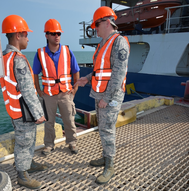 Staff Sgt. Eliseo Guerrero, New Horizons lead logistical planner, Tech. Sgt. Ryan Schnepf, New Horizons contracting officer and Master Sgt. Scott Stambaugh, New Horizons transportation manager, discuss the logistics plan for off-loading more than 64 pieces of equipment coming in by sea at the Port of Belize, March 7. (USAF photo by Master Sgt. Kelly Ogden/Released)
