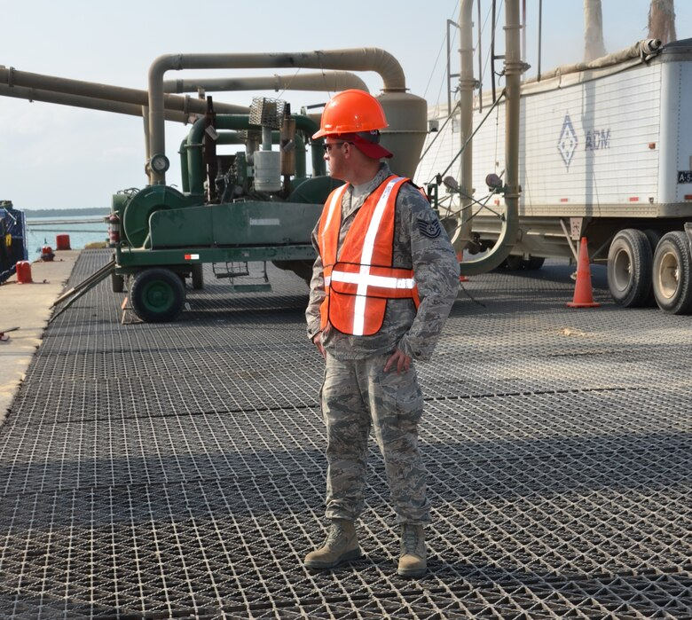 Tech. Sgt. Lance Beaver, New Horizons cargo operations, surveys the Port of Belize in preparation for the large shipment coming into port, March 7. Off-loading more the 64 pieces of equipment (vehicles and shipping containers) will take approximately 10 hours to complete. New Horizons will benefit U.S. military personnel by providing valuable training that they cannot receive at home station because of the details and logistics it takes to execute an out-of-country deployment. The process involves packing and prepping the right equipment and materials in the U.S., working with U.S. Transportation Command to have those items shipped from the U.S. to the exercise location, conducting the exercise itself and then redeploying home. (USAF photo by Master Sgt. Kelly Ogden/Released)