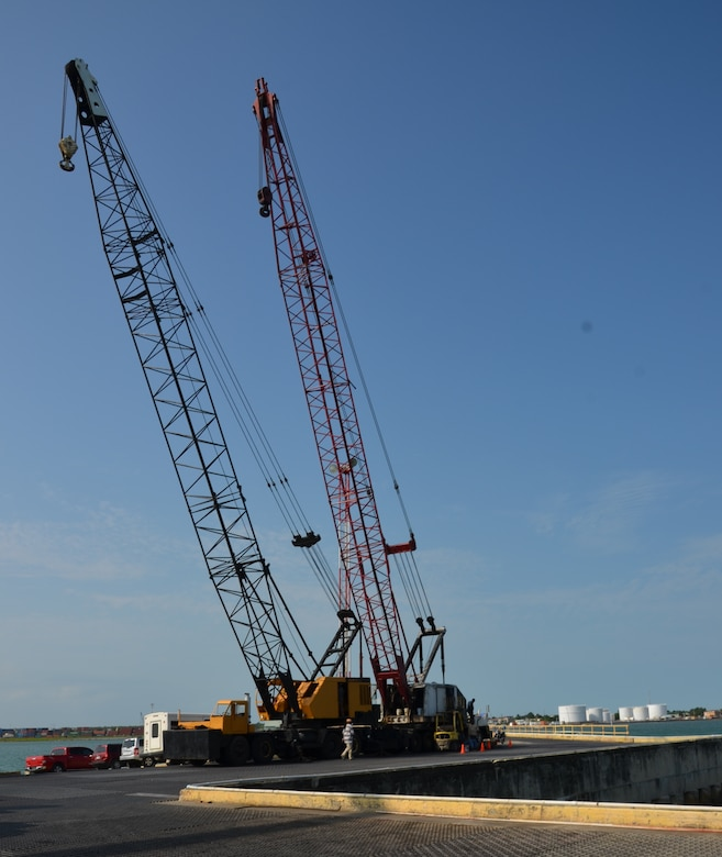 This crane at the Port of Belize will be used to off-load various construction and maintenance vehicles (tractor trailers, dump trucks, excavators, pickups, forklifts, backhoes and gas trucks) and a variety of shipping containers that will be used to support New Horizons exercise requirements, March 7. (USAF photo by Master Sgt. Kelly Ogden/Released)