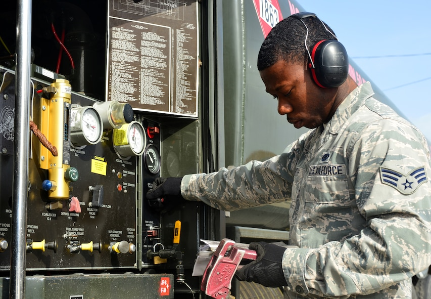 Senior Airman Justin Smith, 39th Logistics Readiness Squadron petroleum, oil and lubricants flight, compares gauge readings to technical orders while refueling March 6, 2014, Incirlik Air Base, Turkey. The Airmen of POL ensure mission readiness at all times by maintaining their own equipment and providing clean fuel by sampling and testing. (U.S. Air Force photo by Staff Sgt. Eric Summers Jr./Released)