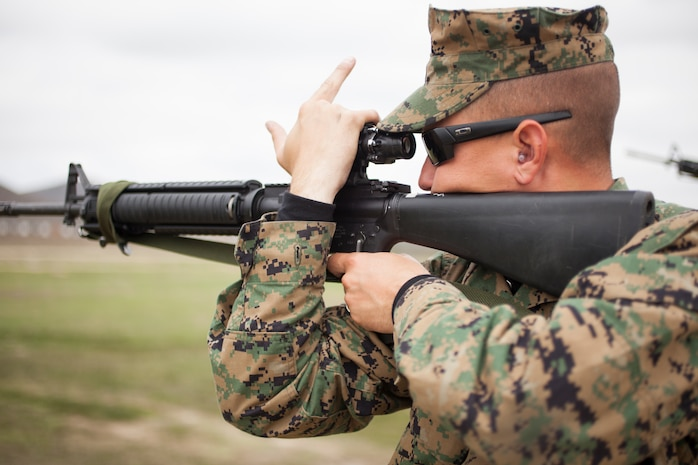 U.S. Marine Corps Sgt.Tyler Webb, recruiter with RSS Fremont, RS San Francisco, 12th Marine Corps District, fires a M16 A-4 service rifle at Wilcox Range aboard Camp Pendleton, Calif., March 4, 2014. Webb was competing in the 2014 Western Division Matches. (U.S. Marine Corps photo by Cpl Catie Masesy, 12th Marine Corps District/Released)