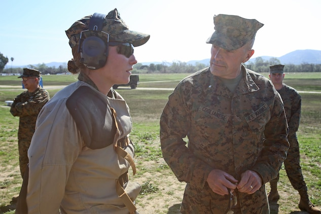 Brig. Gen. Vincent A. Coglianese, commanding general, 1st Marine Logistics Group, speaks to 2nd Lt. Emily A. Conard, platoon commander with General Support Motor Transport Company, Combat Logistics Regiment 1, 1st Marine Logistics Group, about her participation in the 2014 Western Division matches aboard Marine Corps Base Camp Pendleton, Calif., March 5, 2014. Marines from CLRs 17, 1, 15 and 7th Engineer Support Battalion, 1st MLG, competed against approximately 200 Marines from throughout the west coast to prove their marksmanship skills with the M16 service rifle, the M4 carbine and the M9 service pistol, Feb 24 – March 7, 2014.