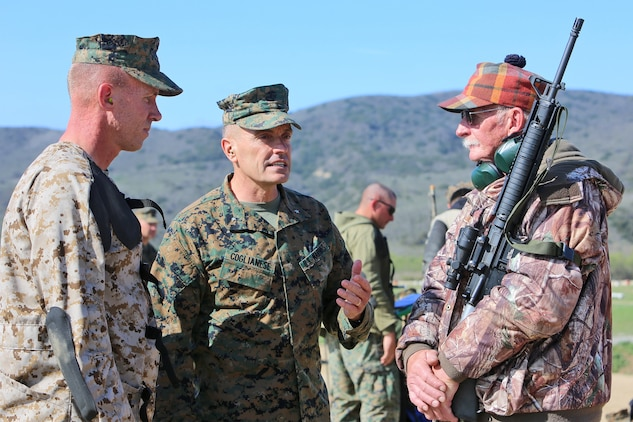 Brig. Gen. Vincent A. Coglianese, commanding general, 1st Marine Logistics Group, offers words of encouragement to Sgt. Erik A. Anderson, a motor vehicle operator with Headquarters Company, Combat Logistics Regiment 15, 1st Marine Logistics Group, and his father Elmo Anderson, as they participate in the 2014 Western Division matches aboard Marine Corps Base Camp Pendleton, Calif., March 5, 2014. Marines from CLRs 17, 1, 15 and 7th Engineer Support Battalion, 1st MLG, competed against approximately 200 Marines from throughout the west coast to prove their marksmanship skills with the M16 service rifle, the M4 carbine and the M9 service pistol, Feb 24 – March 7, 2014.