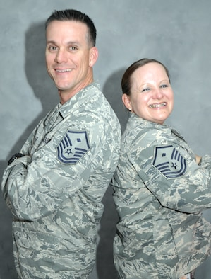 Air Force Master Sgts. Shawn and Lynnette Tolar, who serve as first sergeants for the 380th Expeditionary Force Support Squadron and 380th Expeditionary Communications Squadron, pose for a picture at an undisclosed location in Southwest Asia. The two deployed here in November and learned they are sixth cousins. (U.S. Air Force photo/Master Sgt. April Lapetoda)