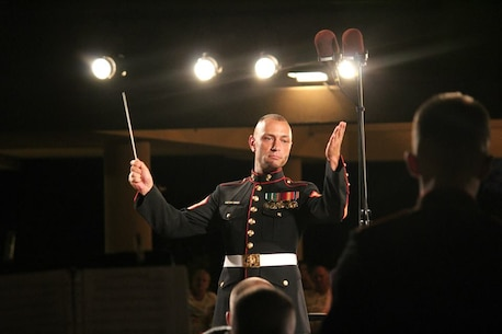 "GySgt Daniel Sullivan, the band's enlisted conductor, conducts ""To Walk With Wings""."
