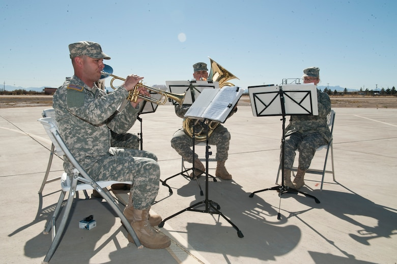 The 1st Armored Division, Band Brass Quintet from Fort Bliss, Texas, performs during the 54th Fighter Group activation ceremony at Holloman Air Force Base, N.M., March 11. The 54th Fighter Group, a tenant unit at Holloman, is a detachment the 56th Fighter Wing at Luke Air Force Base, Ariz., and will ultimately operate two F-16 Fighting Falcon aircraft training squadrons. The 54th Fighter Group plus three squadrons were activated at the ceremony: the 311th Fighter Squadron, the 54th Operations Support Squadron and the 54th Aircraft Maintenance Squadron. (U.S. Air Force photo by Senior Airman Daniel E. Liddicoet/Released)