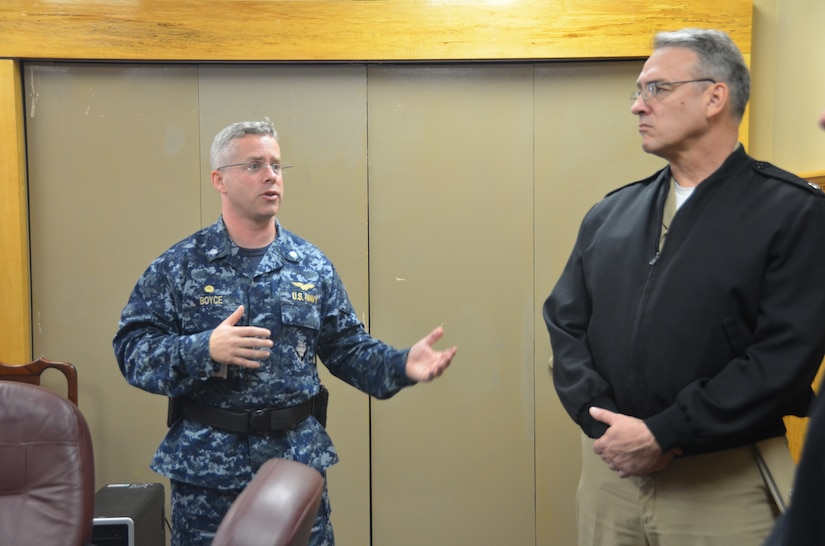 Commander Patrick Boyce, Naval Consolidated Brig Charleston commanding officer, briefs Rear Adm. Rick Williamson, Commander, Navy Region Southeast, on Brig security before taking the admiral on a tour of the facility, March 11, 2014, at Joint Base Charleston – Weapons Station, S.C. (U.S. Air Force photo/Eric Sesit)