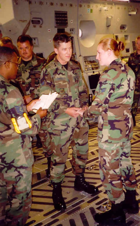 Senior Airman Corrine Price and Airman 1st Class Chris Rekrut are married in the back of a C-17 Globmaster cargo aircraft at what was then McChord Air Force Base, July 19, 2002. The Rekruts have been married for 11 years now, and Chris was promoted to Master Sergeant by means of the Stripes for Exceptional Performers program Dec. 18, 2013, while serving as the 728th Air Mobility Squadron Quality Assurance superintendent at Incirlik Air Base, Turkey. (Courtesy photo)
