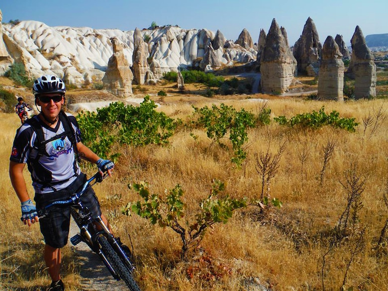 Master Sgt. Chris Rekrut, 728th Air Mobility Squadron Quality Assurance superintendent, pauses during a mountain bike ride near Goreme, Turkey, also known as the region of Cappadocia, in the summer of 2013. Rekrut, who was recently promoted by means of the Stripes for Exceptional Performers program, was actively involved with the Turkey chapter of the Beer Belly Bike Club and played a large role in planning trips such as this one for the group. (Courtesy photo)