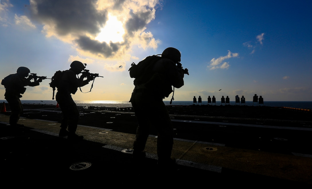GULF OF ADEN - Marines assigned to Battalion Landing Team 1/4, 13th Marine Expeditionary Unit conduct marksmanship training aboard the USS Boxer (LHD 4), March 4, 2014. The 13th MEU is deployed with the Boxer Amphibious Ready Group as a theater reserve and crisis response force throughout the U.S. 5th Fleet area of responsibility.