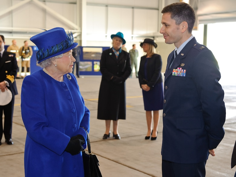 Her Majesty Queen Elizabeth II chats with Capt. Brusle Sherburne of the Air Force Intelligence, Surveillance and Reconnaissance Agency at Royal Air Force Marham, United Kingdom Feb. 3, 2014. Sherburne is the Air Force exchange officer with the Tactical Imagery-Intelligence Wing at Marham, UK. (Courtesy photo)