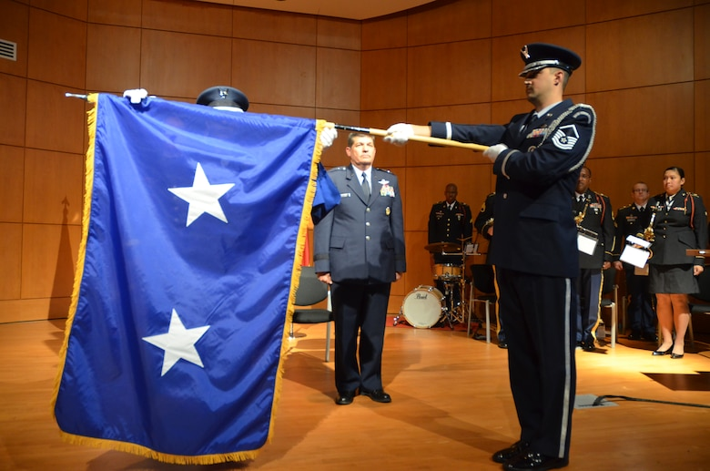 Air Force Color Guard unfurled the two star general officer flag for newly promoted General Officer David Todd Kelly at North Carolina National Guard Joint Force Headquarters on March 7, 2014.  Kelly was promoted to the rank of Air Force Maj. Gen. and will serve as the Air National Guard Assistant to the Commander, Air Mobility Command at Scott Air Force Base, IL.  In this capacity, he will be responsible for advising the commander and staff on all issues impacting the ANG nationally. (U.S. Army National Guard Photo by Sgt Leticia Samuels, North Carolina National Guard Public Affairs/Released)