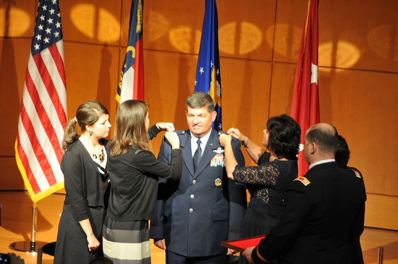 General Officer David Todd Kelly was pinned by his three children Jeremy, Shannon, Melissa and his wife Renee at North Carolina National Guard Joint Force Headquarters, Raleigh, N.C. on March 7, 2014.  Kelly was promoted to the rank of Air Force Maj. Gen. and will serve as the Air National Guard Assistant to the Commander, Air Mobility Command at Scott Air Force Base, IL. (U.S. Air National Guard photo by Master Sgt. Patricia F. Moran, 145th Public Affairs/Released)