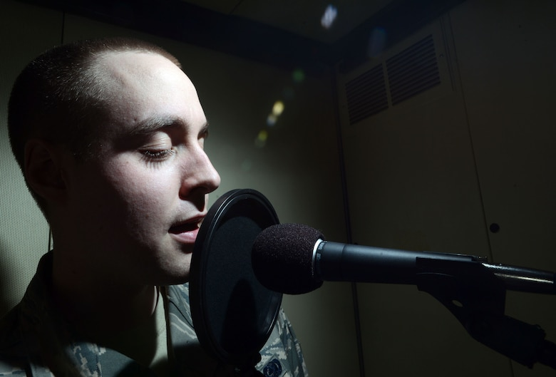 Airman 1st Class Alexander Ross, 673rd Logistic Readiness Squadron fuels technician, sings inside a sound booth at Joint Base Elmendorf-Richardson, Alaska, March 7, 2014. Ross was recently notified of his selection to be part of the 2014 Tops in Blue tour after only 11 months in the Air Force. (U.S. Air Force photo/Staff Sgt. Sheila deVera)