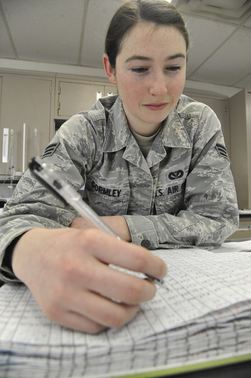 U.S. Air Force Senior Airman Jenifer Gormley, 509th Civil Engineer Squadron water and fuels maintenance journeyman, logs test results into a chemical analysis book at Whiteman Air Force Base, Mo., Feb. 27, 2014. The water plant team keeps records of all test results for state inspections and future reference. (U.S. Air Force photo by Airman 1st Class Keenan Berry/ Released)