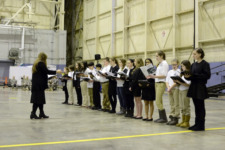 Students of Cornwall Central Middle School 7th and 8th grade choir singing at the start of a pre-deployment ceremony for the 1569th Transportation Company conducted in a hangar at the 105th Airlift Wing, March 9, 2014. (U.S. Air National Guard photo by Tech. Sgt. Michael OHalloran/Released)