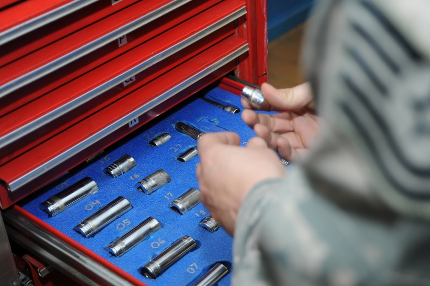 U.S. Air Force Tech. Sgt. Kristina Green, 52nd Equipment Maintenance Squadron conventional munitions maintenance assistant NCO in charge from Vallejo, Calif., inspects tools March 10, 2014, at Spangdahlem Air Base, Germany. An inventory must be completed every time a drawer is opened for accountability of the tools. (U.S. Air Force photo by Airman 1st Class Dylan Nuckolls/Released)