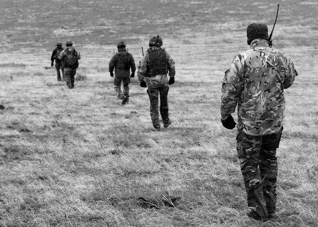 British Army ground troops strategically march to the next objective point during Operation Gunfighter Flag, March 10, 2014, at Saylor Creek Range at Mountain Home Air Force Base, Idaho. MHAFB is the host for this unique exercise, which features the U.S. Air Force, Marine Corps, Navy and British Army. The goal of this operation is to assimilate a joint force that can fly, fight and win. (U.S. Air Force photo by Tech Sgt. JT May III/RELEASED)