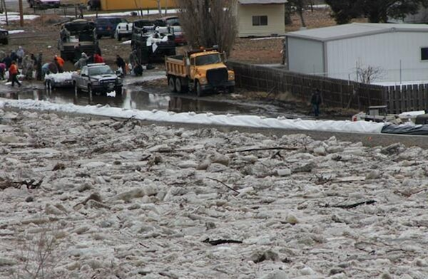 An ice jam pushes water levels close to the top of the levee in Greybull, Wyo. Sandbagging crews from the Wyoming Department of Transportation and the Wyoming National Guard had placed sandbags in low or threatened areas along the Greybull levee at the instruction of John Bartel who was providing technical assistance from the Omaha District.