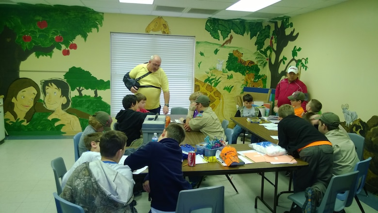 Mark Dixson, a supervisory electrical engineer with the Little Rock District, explains his specialty to a group of Cub Scouts at a science, technology, engineering and mathematics event in Bryant, Ark.  Dixson showed the Scouts how to produce an electrical circuit with a battery.