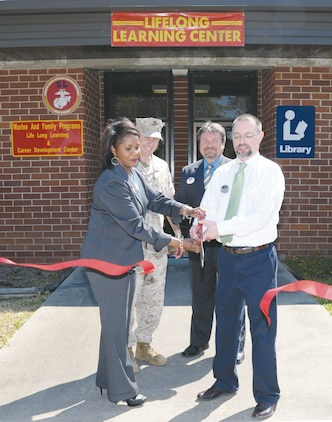 Marine Corps Logistics Base Albany officials conduct a ribbon cutting ceremony for the Lifelong Learning and Career Development Center, here, March 10. The facility accommodates education services, information and referral services, personal financial management, retired activities and transition assistance, to name a few. These services are provided as part of MCLB Albany's Marine and Family Programs.