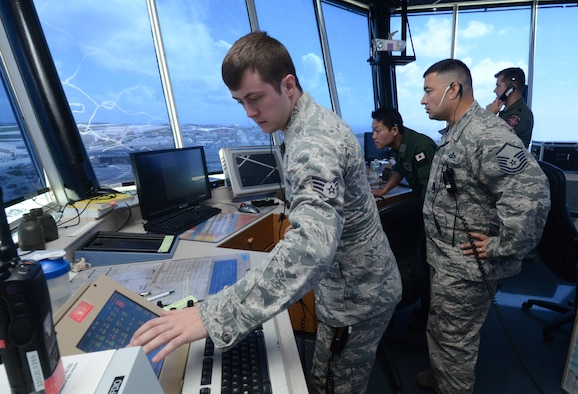 Senior Airman Michael-Paul Kendall, 36th Operations Support Squadron air traffic controller, monitors aircraft movements for Japan Air Self-Defense Force and U.S. Air Force aircraft Feb. 24, 2014, during Exercise Cope North 2014 on Andersen Air Force Base, Guam. The exercise, which is a joint effort between the U.S. Air Force, the Japan Air Self-Defense Force and the Royal Australian Air Force, is designed for allies to work together on both humanitarian assistance and disaster relief (HA/DR) missions as well as large force employment mission with dissimilar aircraft. (U.S. Air Force photo by Airman 1st Class Emily A. Bradley/Released)