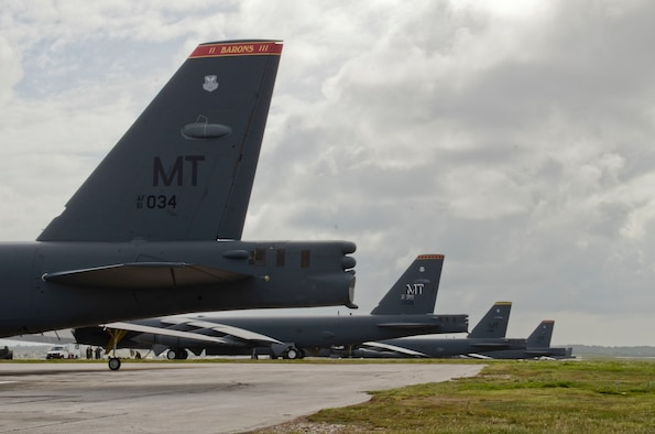 B-52H Stratofortresses from Minot Air Force Base, N.D., are parked on the flightline on Andersen Air Force Base, Guam, March 11, 2014. The Airmen with the 69th Expeditionary Bomb Squadron deployed with the B-52s as part of the continuous bomber presence mission to maintain a prudent, long-standing deterrent capability throughout the Asia-Pacific region. (U.S. Air Force photo by Airman 1st Class Emily A. Bradley/Released)