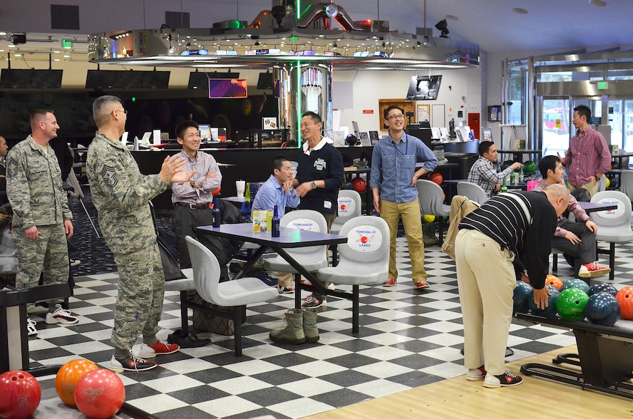 Yokota Air Base, Japan - Members of the 374th Airlift Squadron leadership along with local Japanese Air Self Defense Force senior enlisted leaders get together along with exchange students from both branches during a bowling event to conclude the Yokota portion of the Non-Commissioned Officer Exchange Program at Yokota Air Base, Japan, Feb. 24, 2014.  Eight NCO's from various JASDF bases came to Yokota and were sponsored by eight NCO's of the same careers from the 374th.  The host NCO's showed them how Yokota conducts its mission, as well as introduced them to some American culture.  The host NCO's then traveled to Komaki Air Base, Japan, where they were hosted by JASDF members to see how their counterparts conduct their mission.  (U.S. Air Force photo by Tech. Sgt. Christopher Marasky/Released)