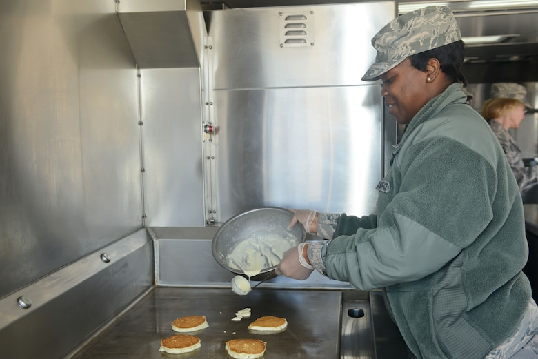U.S. Air Force Senior Airman Deatrice Peake, 116th Force Support Squadron, Services Flight (FSS/FSV), Georgia Air National Guard, Robins Air Force Base, Ga., cooks pancakes on a grill in a Deployable Ready Mobile Kitchen Trailer (DRMKT) while training with the 136th FSS/FSV, Texas Air National Guard, at Naval Air Station Fort Worth Joint Reserve Base, Texas, Feb. 22, 2014. Members of the 116th FSS/FSV participated in the two-day training event in anticipation of receiving their own DRMKT in July 2014. (U.S. Air National Guard photos by Master Sgt. Charles Hatton/Released)