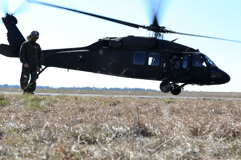 A UH-60 Black Hawk takes of from McEntire Joint National Guard Base after being refueled by Marines with Marine Wing Support squadron 273, Feb. 27. The exercise gave the soldiers at McEntire the opportunity to learn Marine Corps hand and arm signals while Marines got familiar with aircraft such as the Black Hawk.