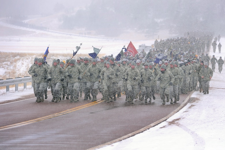 """Class of 2016 cadets brave freezing temperatures and snow on their """"Run to the Rock,"""" March 9, 2013. The run is an annual Academy tradition heralding the start of Recognition for freshman cadets. (U.S. Air Force Photo/Sarah Chambers)"""