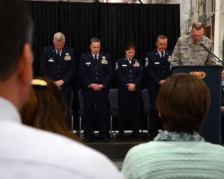 PEASE AIR NATIONAL GUARD BASE, N.H. -- Chaplain Robert J. Cordery delivers the invocation during the 157th Air Refueling Wing Change of Authority Ceremony in Hanger 254 as (left to right) Col. Paul Hutchinson, 157th Air Refueling Wing commander; Col. Peter Sullivan, 157th Air Refueling Wing vice commander; Command Chief Master Sgt. Brenda Blonigen; and incoming Command Chief Master Sgt. Jamie Lawrence look on. Lawrence replaces Chief Master Sgt. Brenda Blonigen who served in the position for more than five years. Lawrence previous role was as the 66th Force Support Squadron superintendent. (N.H. National Guard photo by Tech. Sgt. Mark Wyatt/RELEASED)