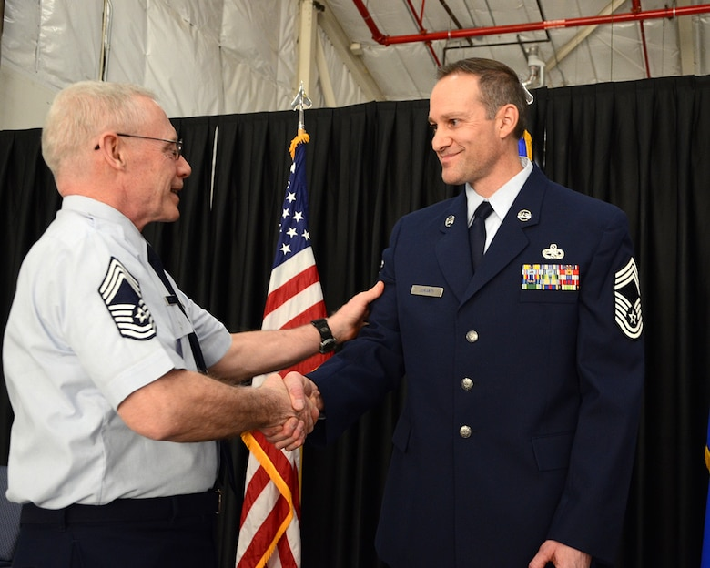 PEASE AIR NATIONAL GUARD BASE, N.H. -- Chief Master Sgt. John M. Menton, 157th Maintenance Group, congratulates newly promoted Chief Master Sgt. Michael W. Juranty, also assigned to the 157th Maintenance Group, upon his promotion to the enlisted force's most senior rank, March 9, 2014. Juranty is a traditional member of the maintenance group and the first to hold the enlisted position in more four years. (N.H. National Guard photo by Tech. Sgt. Mark Wyatt/RELEASED)