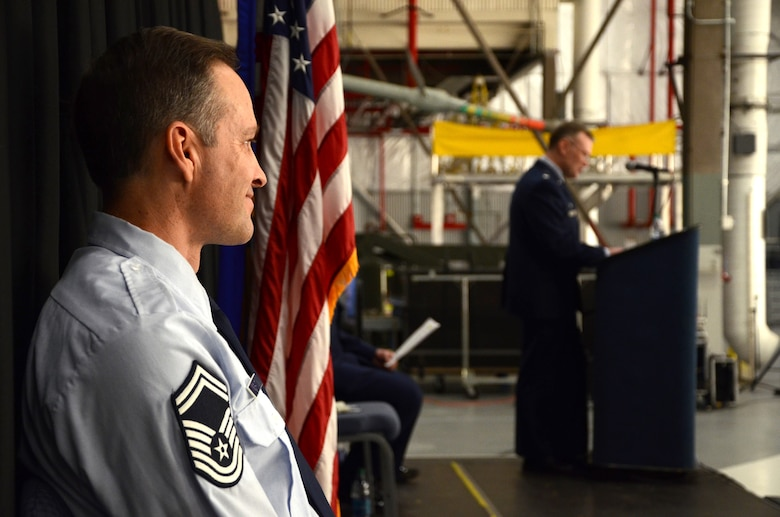 PEASE AIR NATIONAL GUARD BASE, N.H. -- Senior Master Sgt. Michael W. Juranty, 157th Maintenance Group Aircraft Maintenance superintendent, looks out over the crowd during a promotion ceremony to chief master sergeant in Hanger 254 as Lt. Col. John W. Pogorek, 157th Maintenance Group commander, speaks at the podium here March 9, 2014. Juranty is a traditional member of the maintenance group and the first to hold the enlisted position in more four years. (N.H. National Guard photo by Tech. Sgt. Mark Wyatt/RELEASED)