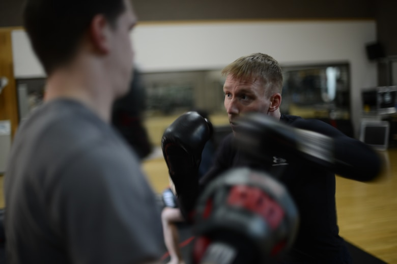U.S. Air Force Senior Airman Sean Whitaker, a Spangdahlem mixed martial arts member from Pittsburgh, practices striking techniques inside the Skelton Memorial Fitness Center at Spangdahlem Air Base, Germany, March 11, 2014. Whitaker attends MMA and grappling training three days a week to stay competent with fighting skills. (U.S. Air Force photo by Senior Airman Gustavo Castillo/Released)