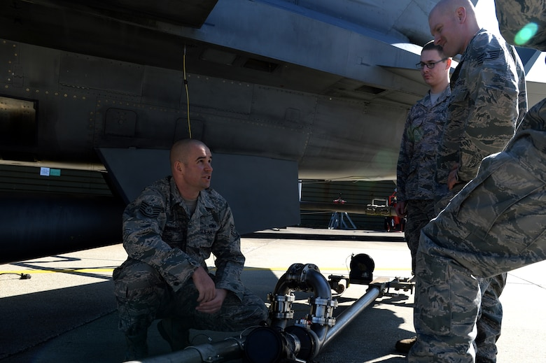 U.S. Air Force Tech. Sgt. Jeff Current, 52nd Maintenance Group maintenance operations F-16 Fighting Falcon fighter aircraft maintenance instructor and NCO in charge of instruction, briefs a class of Airmen responsible for fueling aircraft on hot pits at Spangdahlem Air Base, Germany, March 10, 2014. Hot pits are a procedure that allows aircraft to remain running while being refueled. (U.S. Air Force photo by Senior Airman Alexis Siekert/Released)