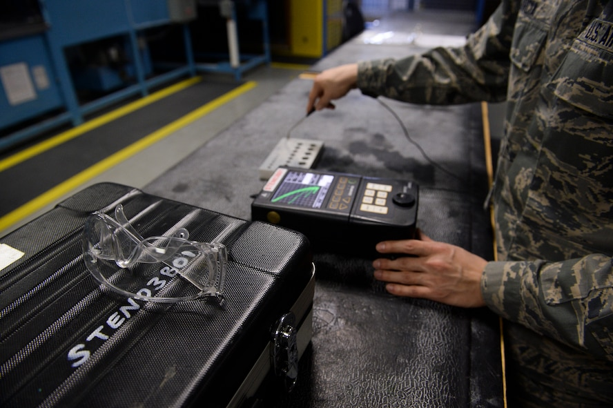 U.S. Air Force Airman 1st Class Christopher Garcia, a 52nd Equipment Maintenance Squadron non- destructive inspection apprentice from Tucson, Ariz., calibrates an Eddie current unit March 7, 2014, at Spangdahlem Air Base, Germany. The Eddie current unit detects small cracks on the aircraft that are too small for the human eye to see. (U.S. Air Force photo by Senior Airman Rusty Frank/Released)