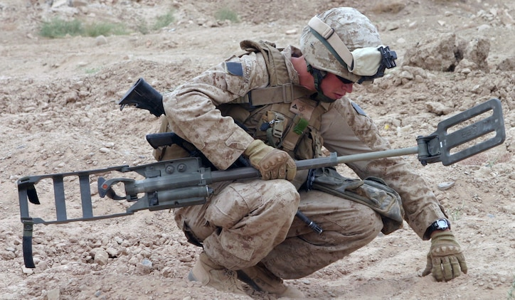 During Operation Enduring Freedom in Afghanistan, a Marine probes an area after his Ground Penetrating Radar Metal Detector set off an alarm. Counter-improvised explosive device systems such as this are under scrutiny by the C-IED War Room at Marine Corps Systems Command at Quantico, Va.