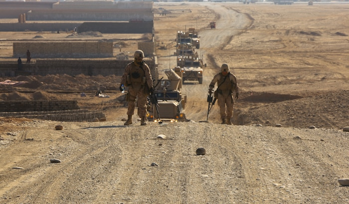 Marines sweep a road in Afghanistan using counter-improvised explosive device systems. These types of systems are under scrutiny by the Counter-IED War Room at Marine Corps Systems Command at Quantico, Va.