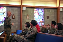Sgt. Maj. Robert A. Allen Jr. gives the opening remarks at the third annual Vivian A. Holmes Female Marine Symposium, Feb. 25. (U.S. Marine Corps photo by Cpl. Mary M. Carmona/Released.)