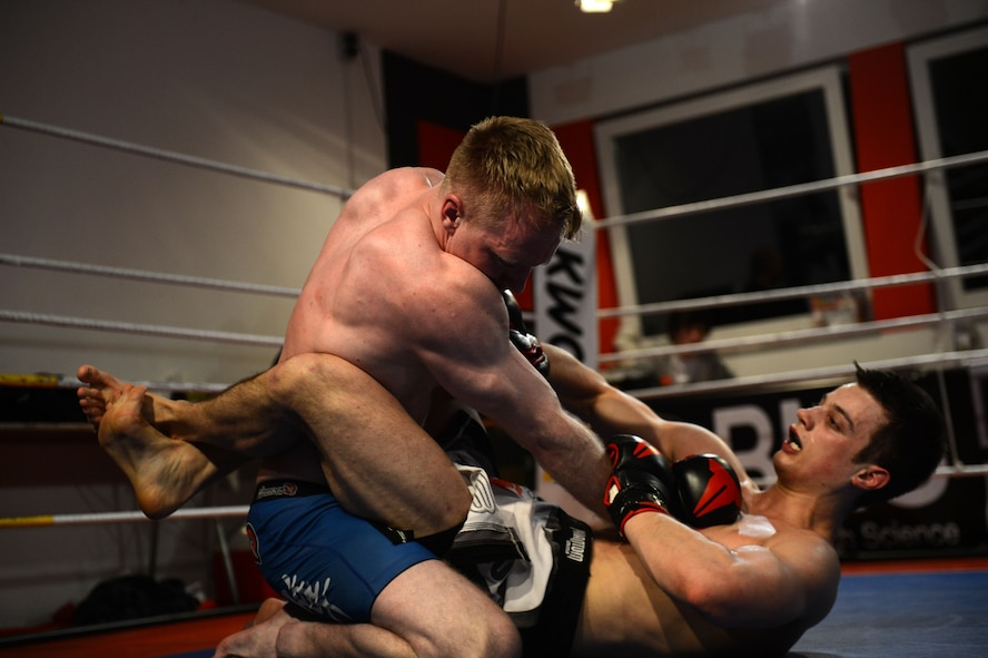 U.S. Air Force Senior Airman Sean Whitaker, a Spangdahlem mixed martial arts member from Pittsburgh, fights for position over his opponent during his match at an MMA tournament in Pruem, Germany, March 8, 2014. Fighters have approximately six weeks notice before fighting in an event; Whitaker had only 12 days to prepare due to last-minute changes in the lineup. (U.S. Air Force photo/Senior Airman Gustavo Castillo)